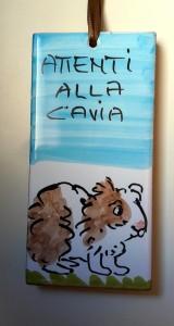 """En keramikskylt som jag köpte i Italien. """"Attenti alla cavia"""" - Varning för marsvin."""